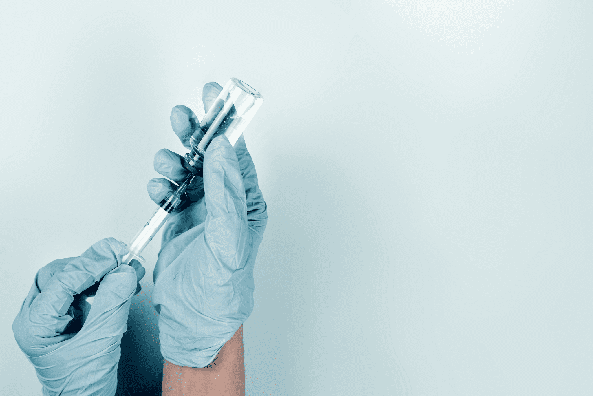 doctor gloves holding vaccination